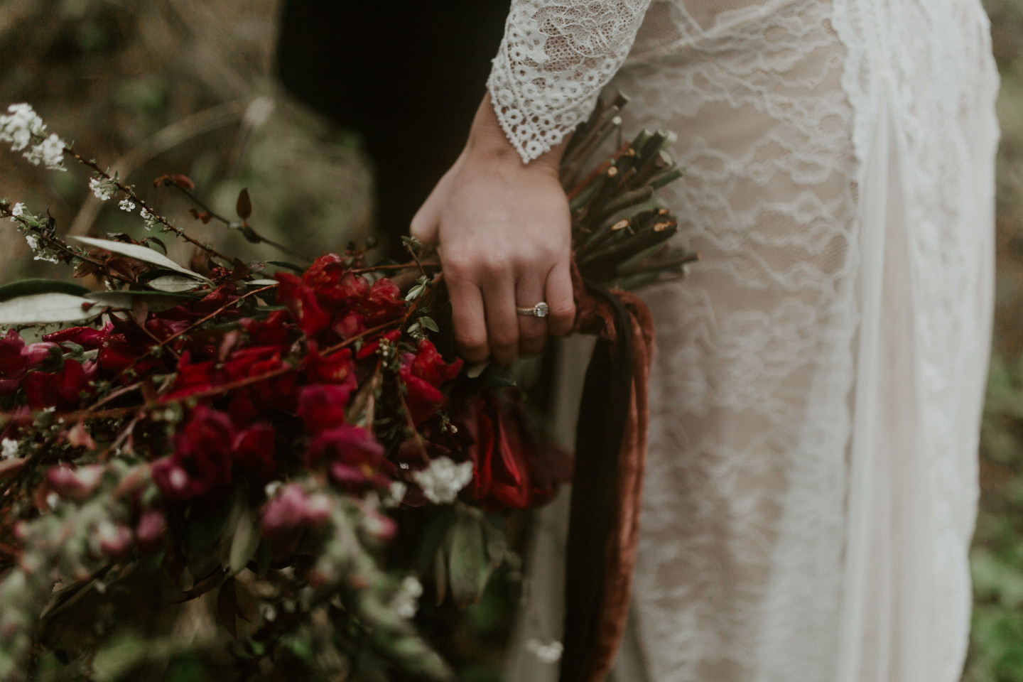 A close up of Hannah's ring and bouquet at Cannon Beach, Oregon. Wedding photography in Portland Oregon by Sienna Plus Josh.