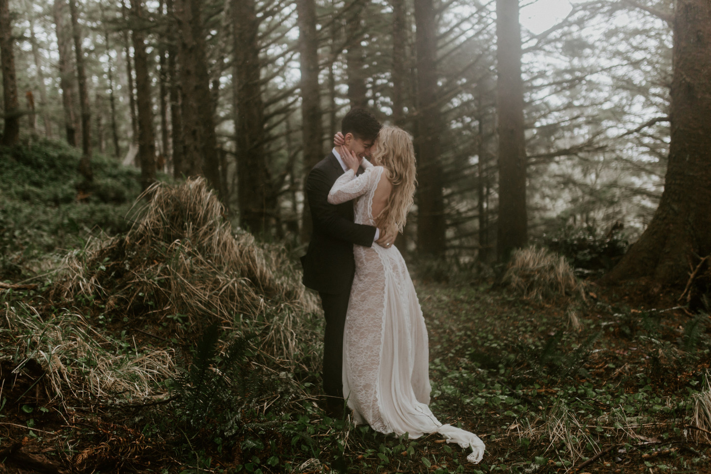 Hannah and Grant in the trees of Cannon Beach, Oregon. Wedding photography in Portland Oregon by Sienna Plus Josh.
