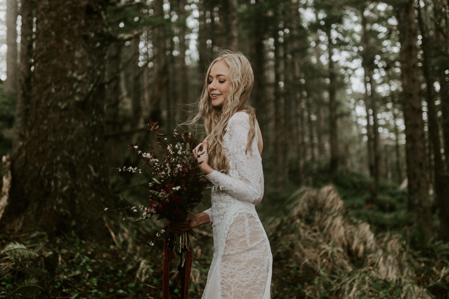 Hannah stands alone in the woods of Cannon Beach, Oregon during her Oregon coast elopement. Wedding photography in Portland Oregon by Sienna Plus Josh.