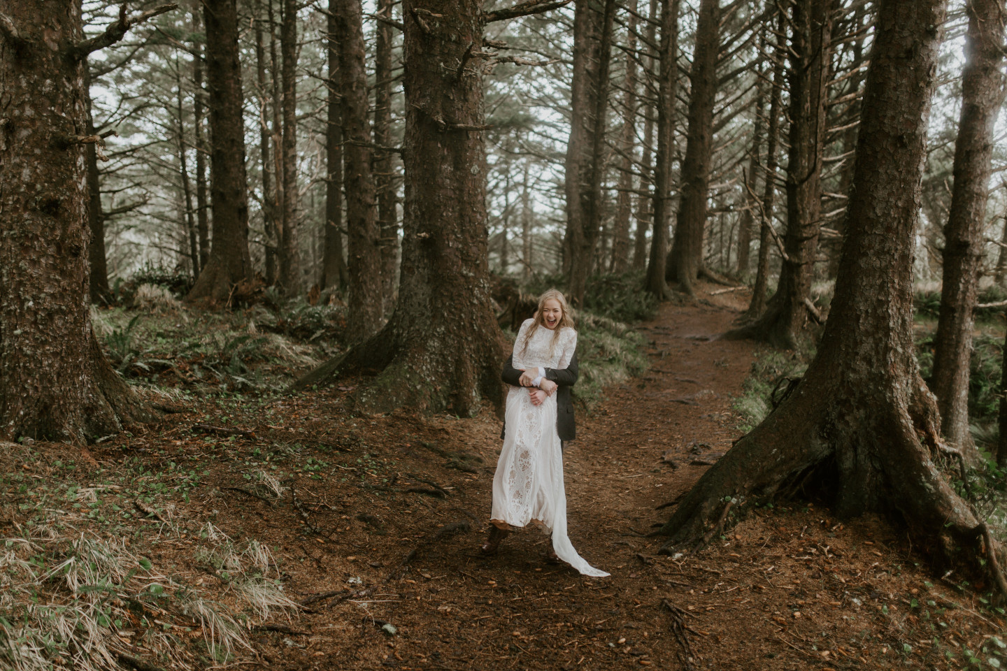 Grant lifts Hannah up during their Oregon coast elopement. Wedding photography in Portland Oregon by Sienna Plus Josh.