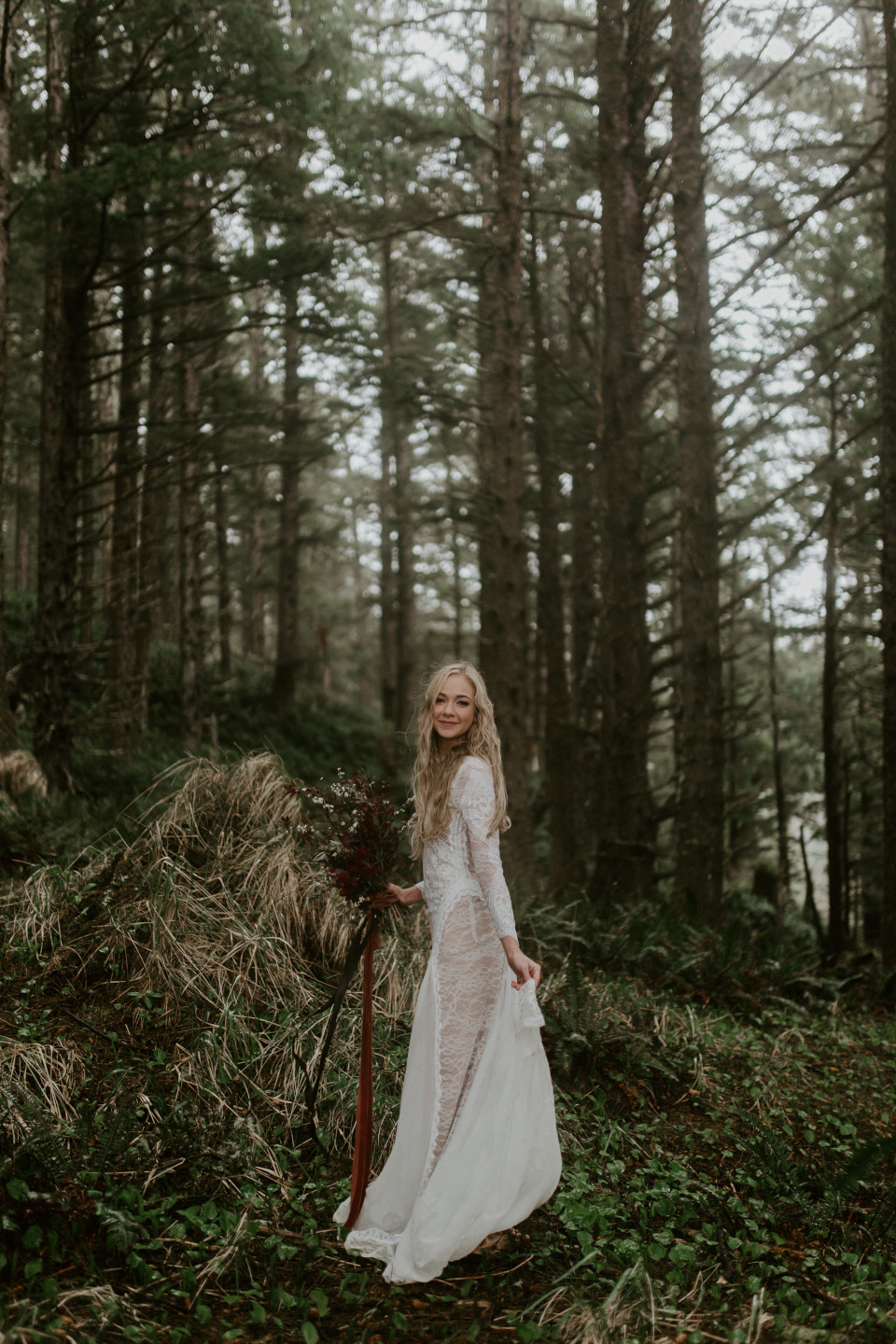 Hannah smiles for her picture among the trees at Cannon Beach, Oregon for her Oregon coast elopement. Wedding photography in Portland Oregon by Sienna Plus Josh.