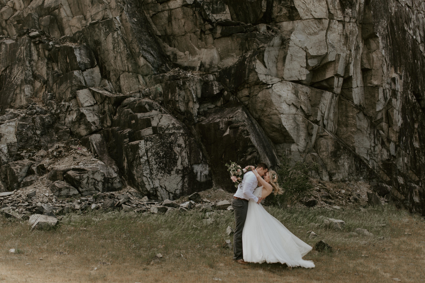 Harper and Trevor embrace at Cascade Locks, Oregon. Elopement photography in Portland Oregon by Sienna Plus Josh.