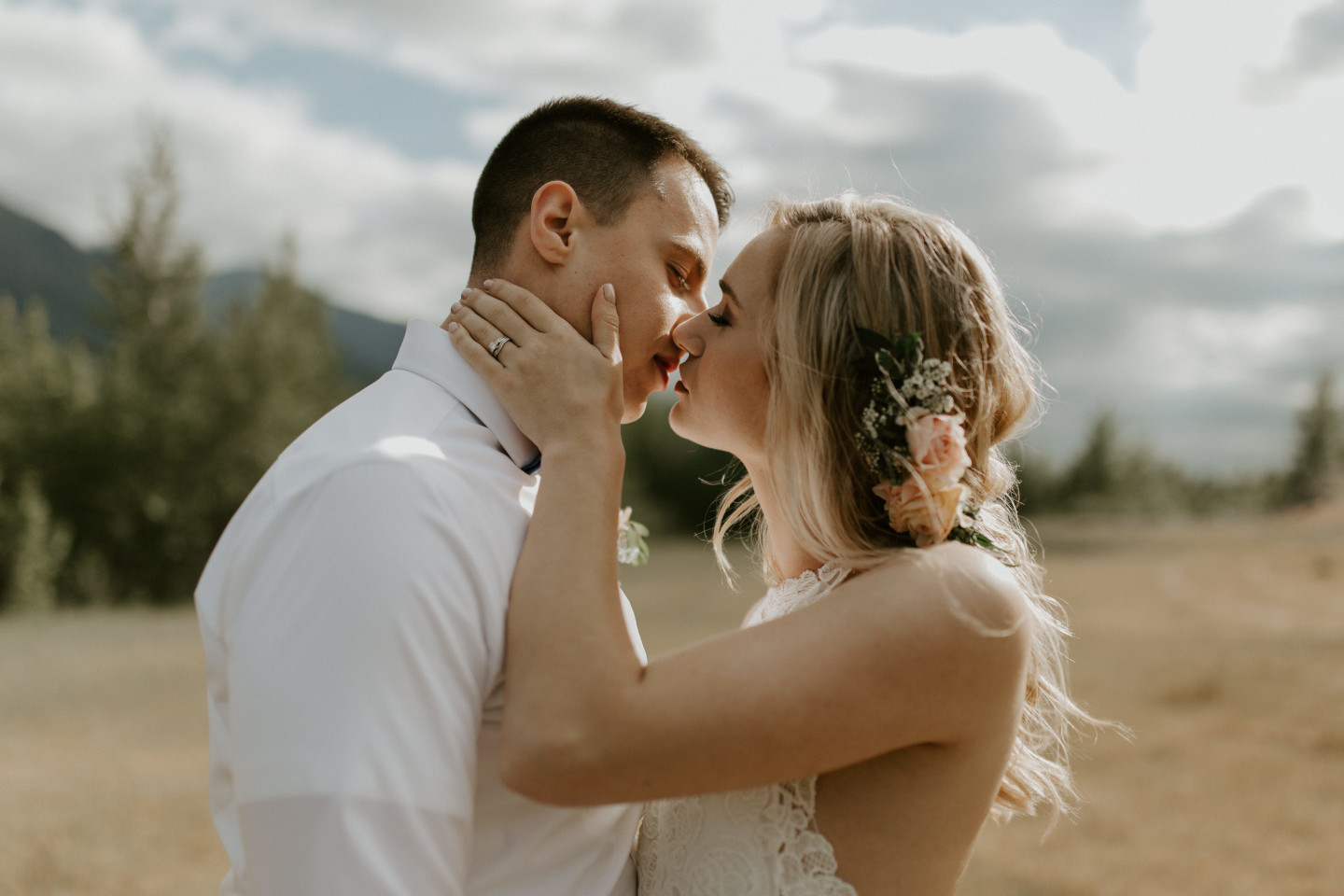 Harper and Trevor go in for a kiss at Cascade Locks in Oregon. Elopement photography in Portland Oregon by Sienna Plus Josh.