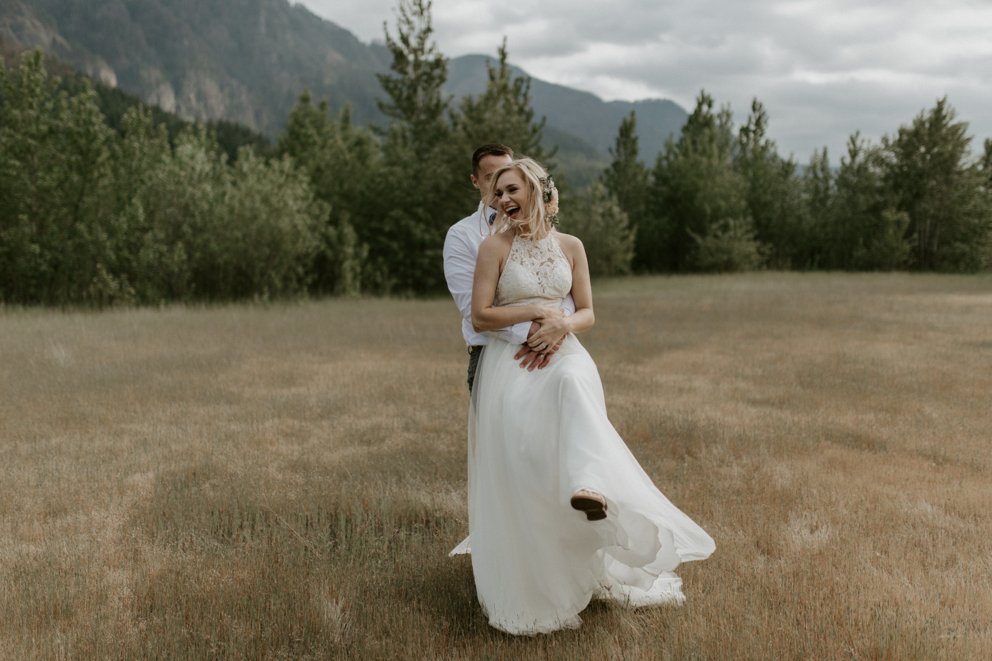 Trevor hugs Harper at Cascade Locks, Oregon. Elopement photography in Portland Oregon by Sienna Plus Josh.