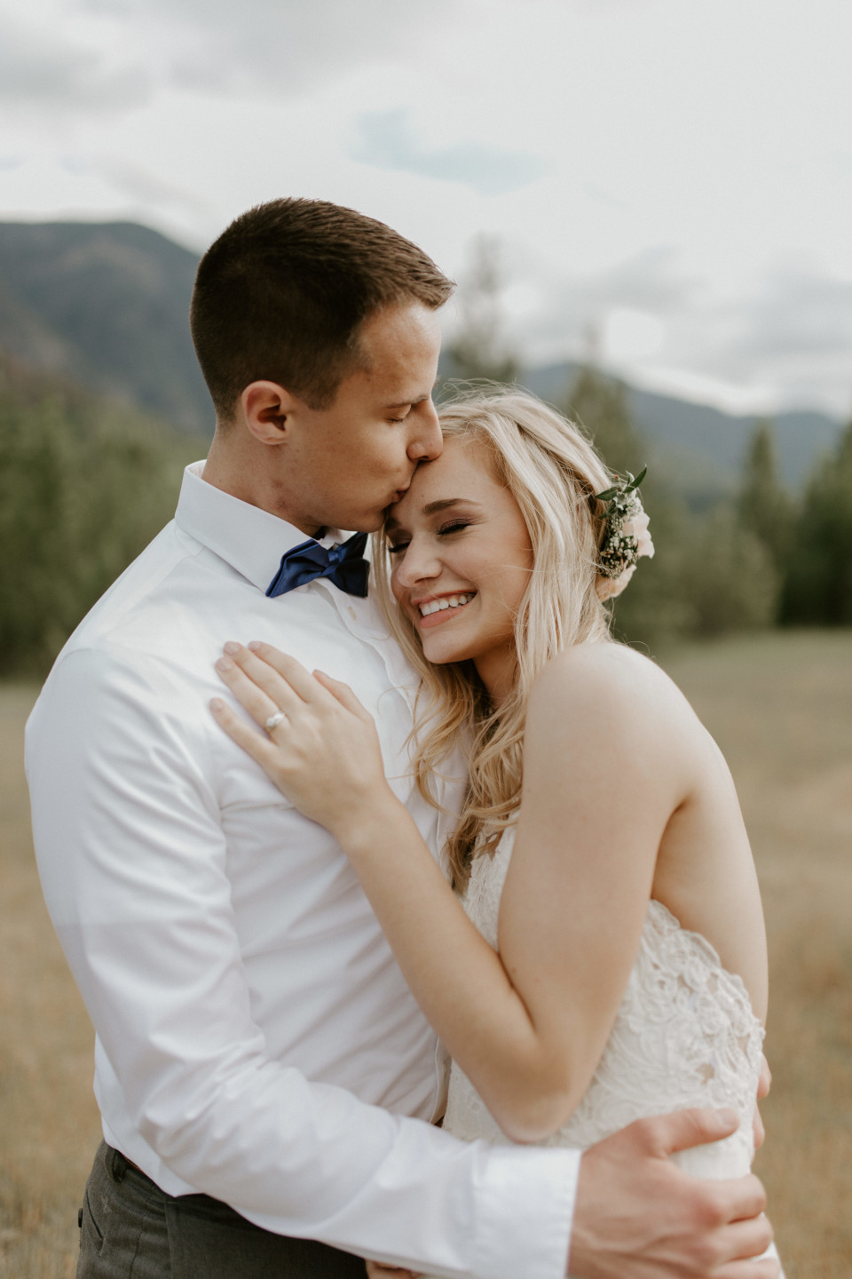 Trevor kisses Harper's forehead at Cascade Locks, Oregon. Elopement photography in Portland Oregon by Sienna Plus Josh.