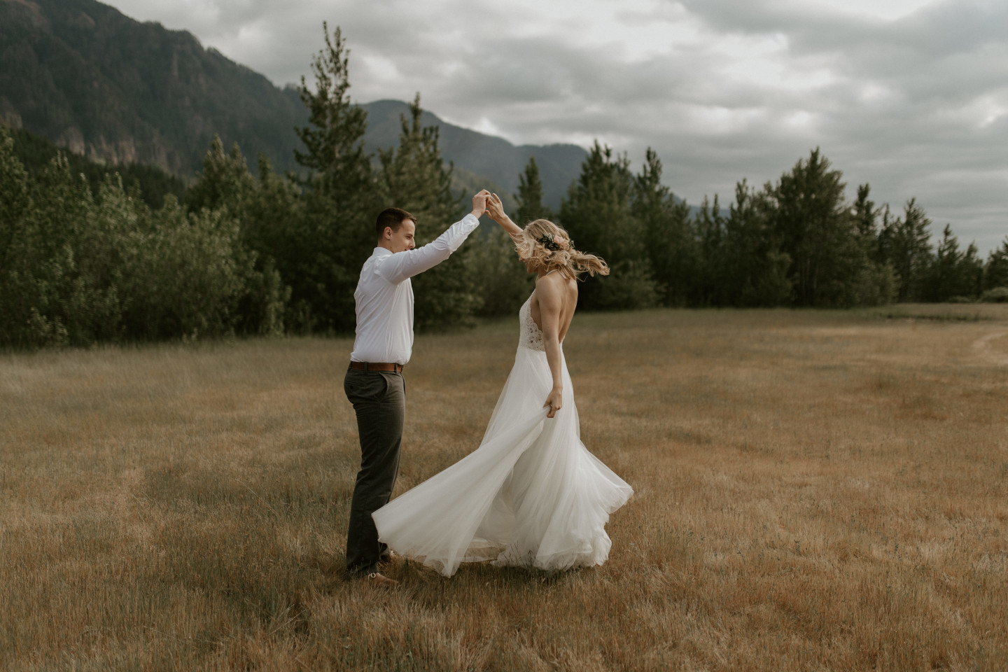 Trevor spins Harper at Cascade Locks in Oregon during their Adventure. Elopement photography in Portland Oregon by Sienna Plus Josh.