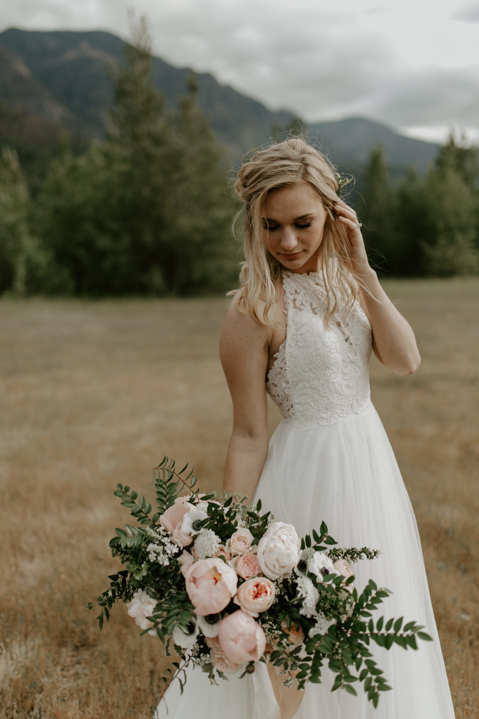 Harper stands alone at Cascade Locks, Oregon during their Oregon Adventure. Elopement photography in Portland Oregon by Sienna Plus Josh.