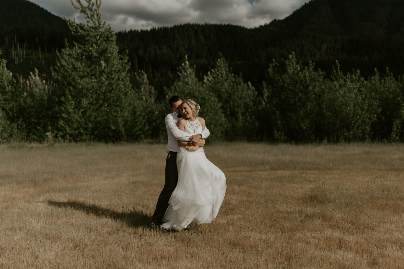 Harper laughs as Trevor holds her at Cascade Locks at the Columbia Gorge, Oregon. Elopement photography in Portland Oregon by Sienna Plus Josh.