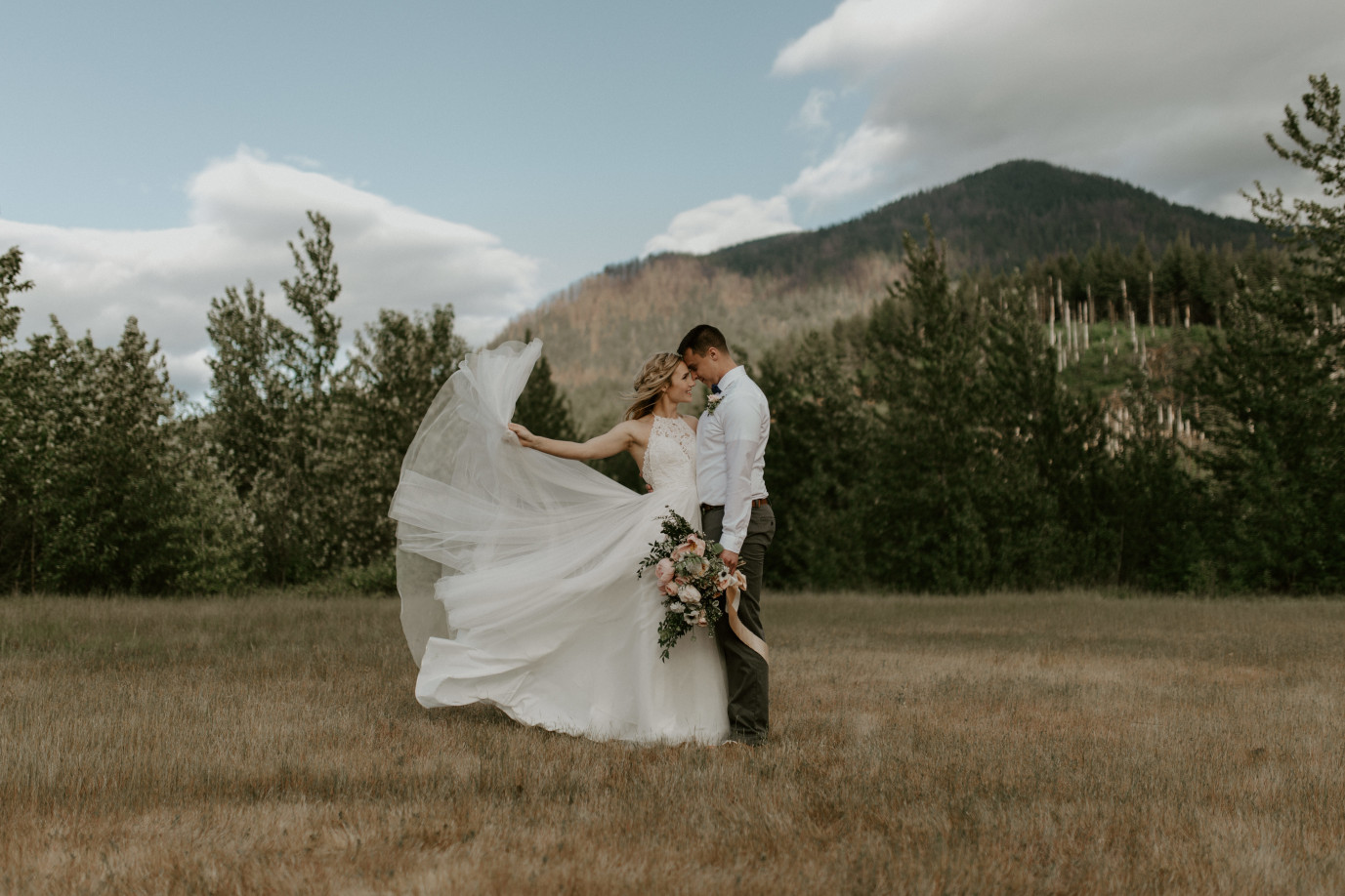 Harper throws her dress train into the air at Cascade Locks at the Columbia Gorge, Oregon. Elopement photography in Portland Oregon by Sienna Plus Josh.