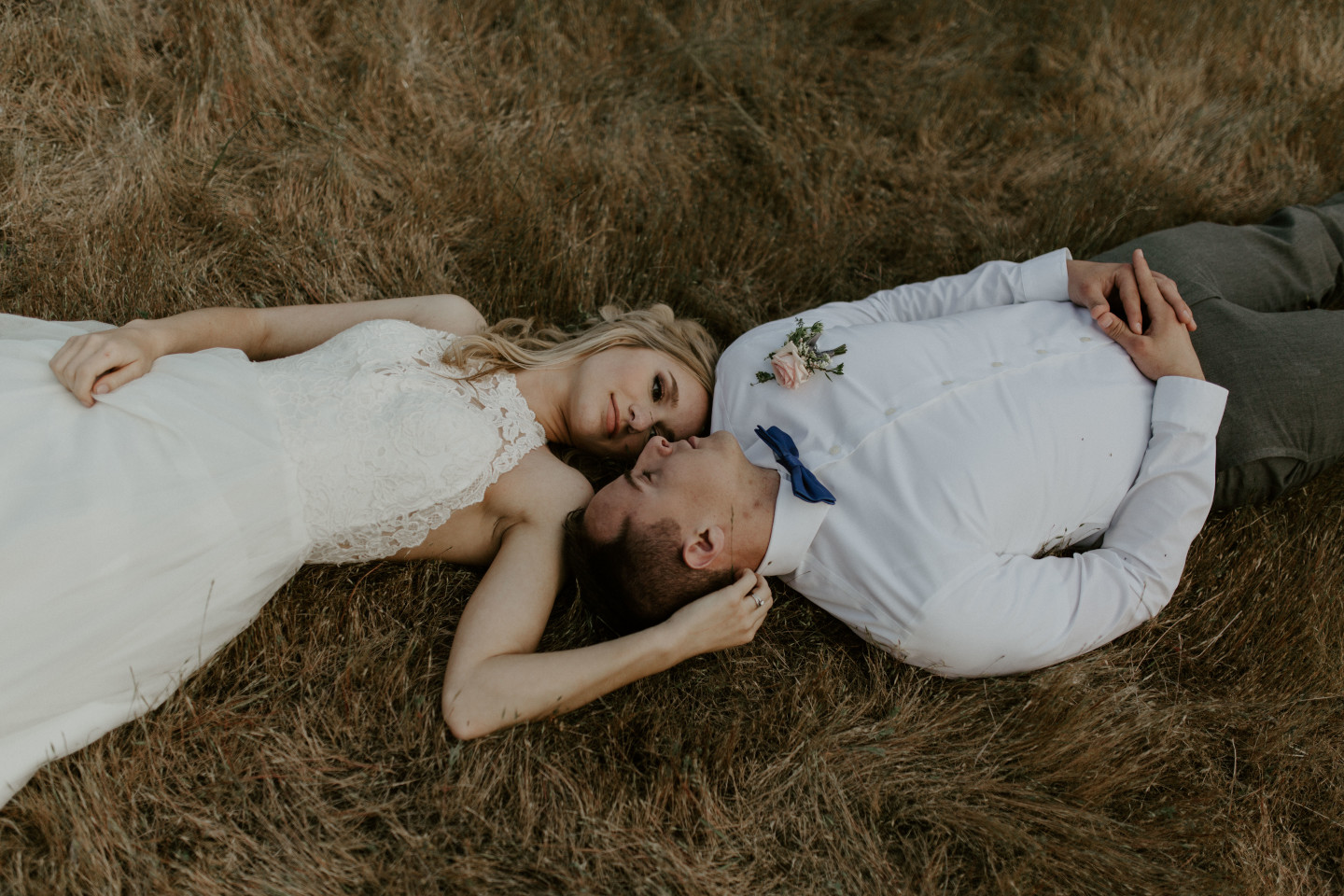 Harper and Trever lay on the ground at Cascade Locks at the Columbia Gorge, Oregon. Elopement photography in Portland Oregon by Sienna Plus Josh.