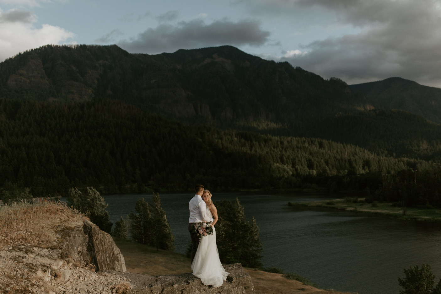 Harper and Trevor stand near the cliffs at Cascade Locks at the Columbia Gorge, Oregon. Elopement photography in Portland Oregon by Sienna Plus Josh.