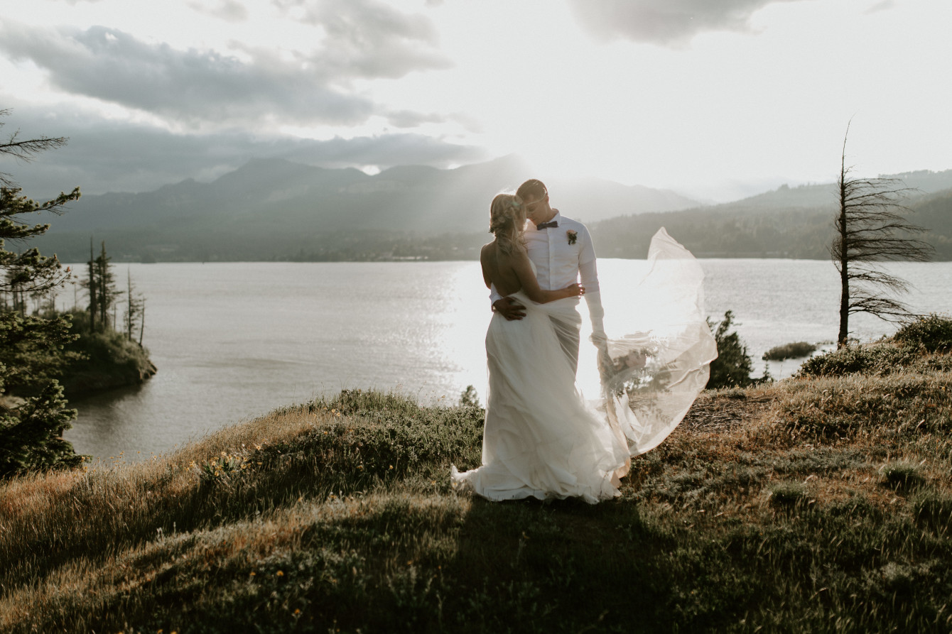 Harper and Trevor stand near the river at Cascade Locks at the Columbia Gorge, Oregon. Elopement photography in Portland Oregon by Sienna Plus Josh.
