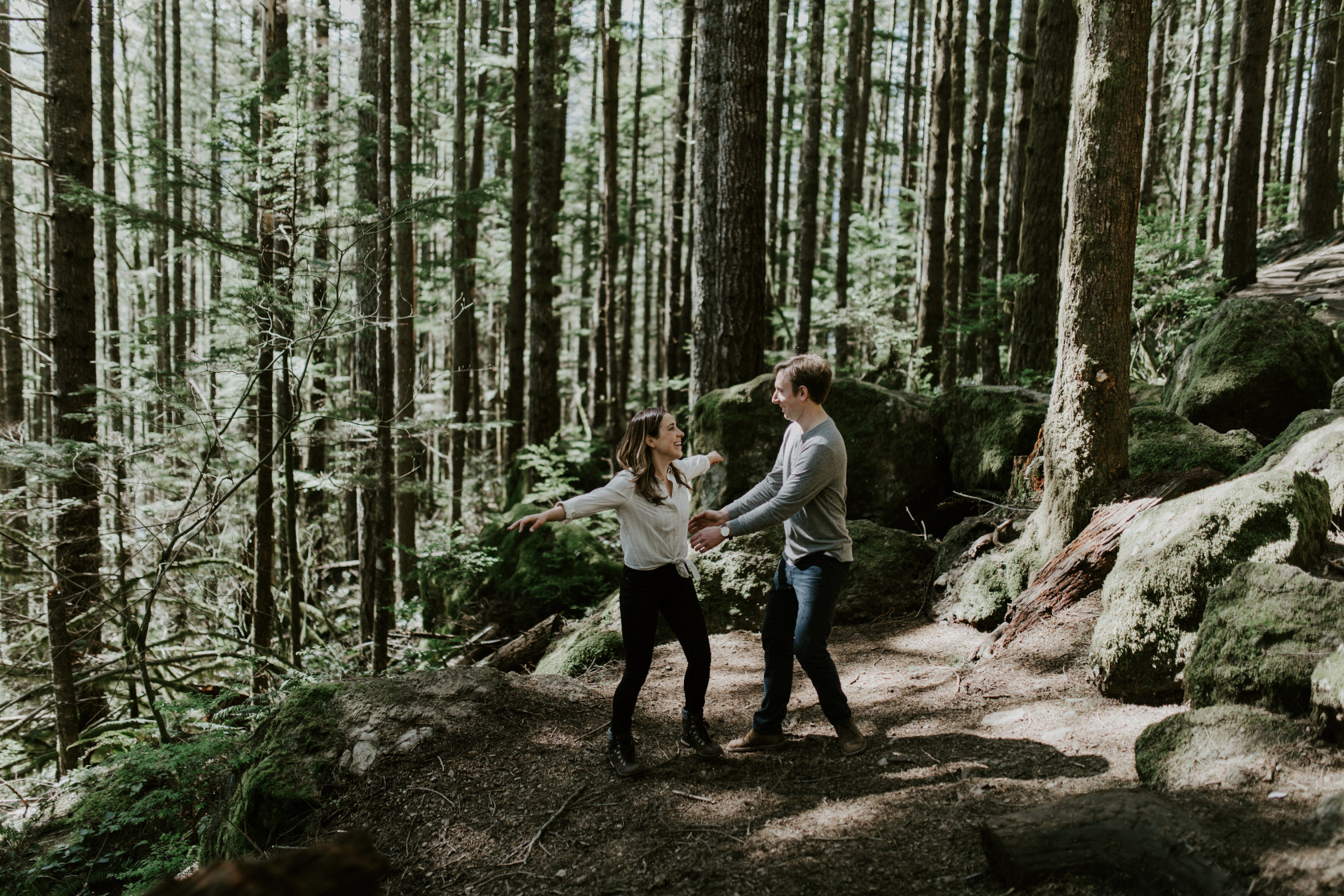 Janelle and Adam go in for a hug. Adventure engagement session at Rattlesnake Lake, Washington by Sienna Plus Josh.
