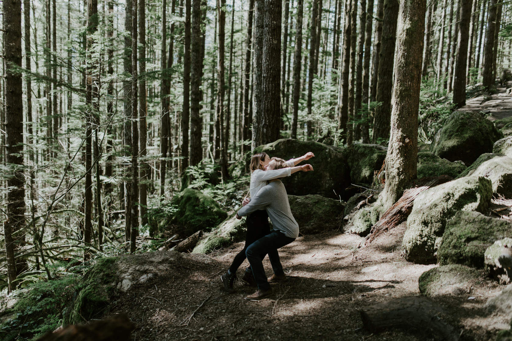 Janelle and Adam go in for a hug at Rattlesnake Lake, WA. Adventure engagement session at Rattlesnake Lake, Washington by Sienna Plus Josh.