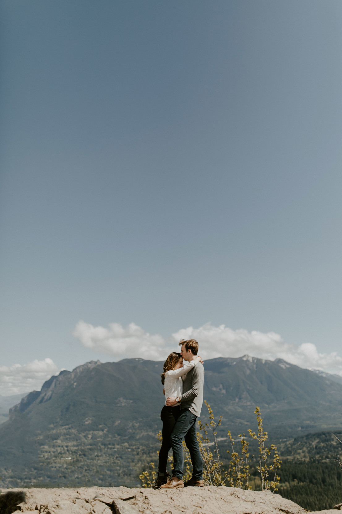 Adam kisses Janelle on the forehead. Adventure engagement session at Rattlesnake Lake, Washington by Sienna Plus Josh.