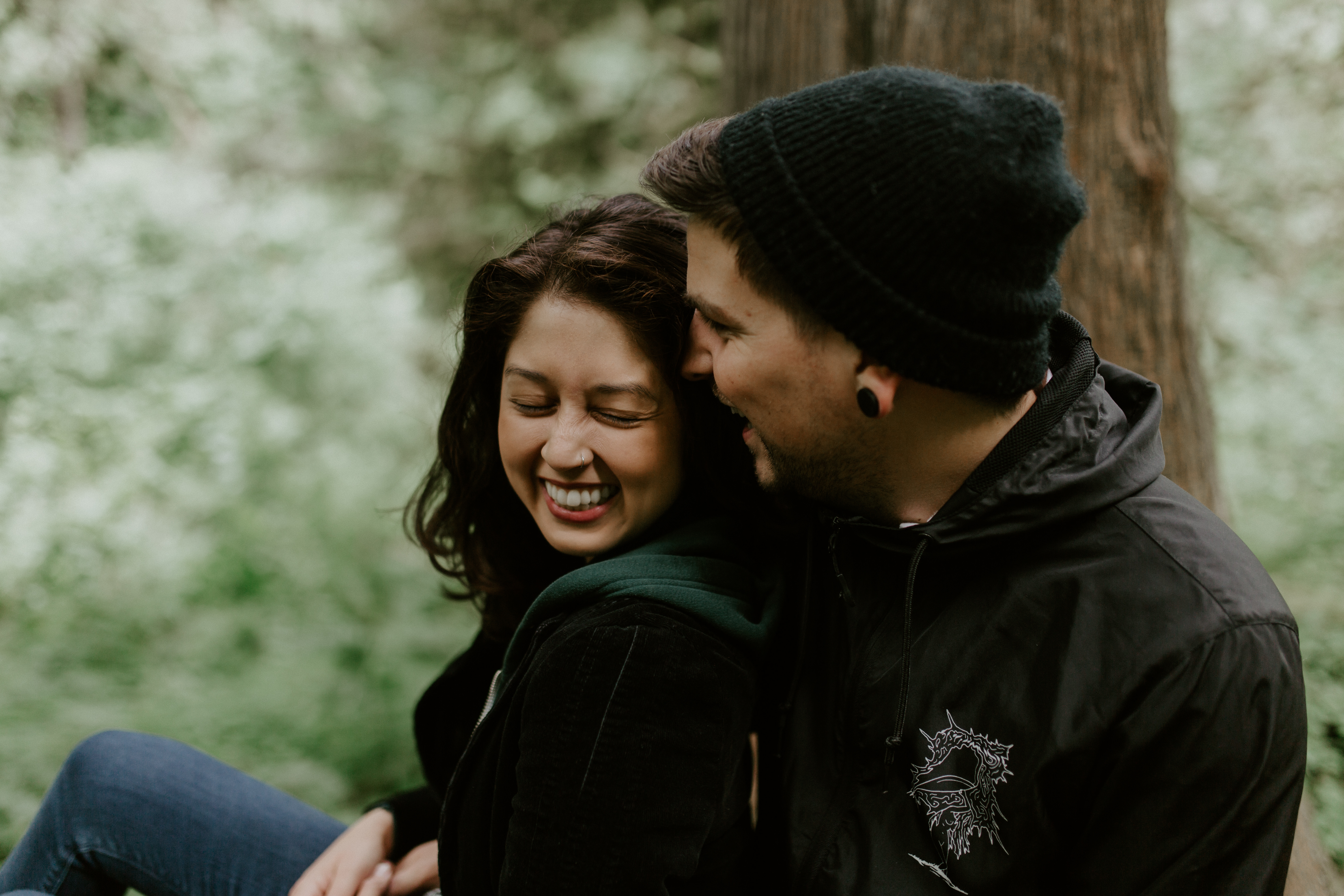 Chris whispers to Jasmine at Latourell Falls, Oregon. Adventure photography in Portland Oregon by Sienna Plus Josh.