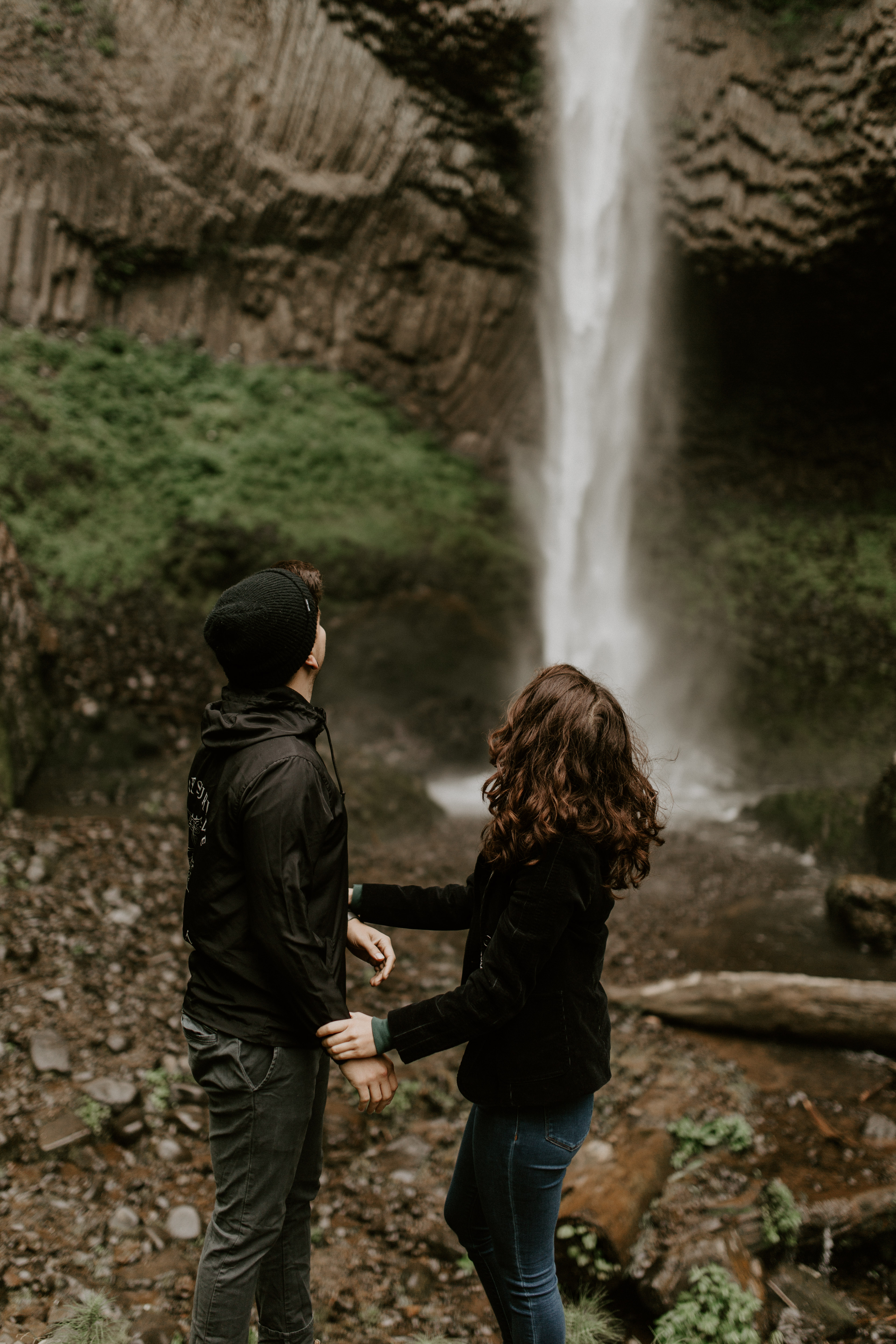 Jasmine and Chris stand at the lower falls at Latourell Falls in Oregon. Adventure photography in Portland Oregon by Sienna Plus Josh.