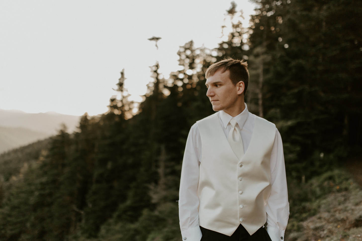 Ryan stands alone near the view of Mount Hood. Adventure elopement wedding shoot by Sienna Plus Josh.