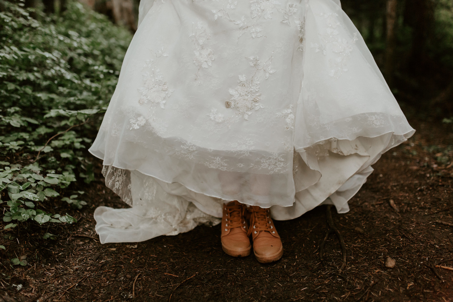 Moira shows off her adventure shoes. Adventure elopement wedding shoot by Sienna Plus Josh.