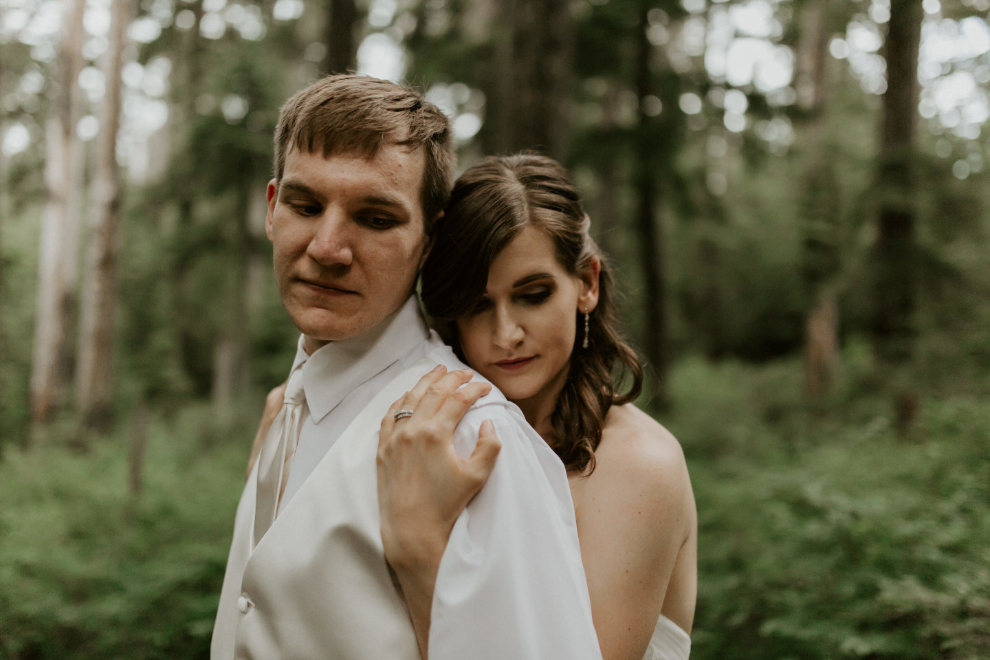 Moira holds Ryan along the trail to Mount Hood. Adventure elopement wedding shoot by Sienna Plus Josh.