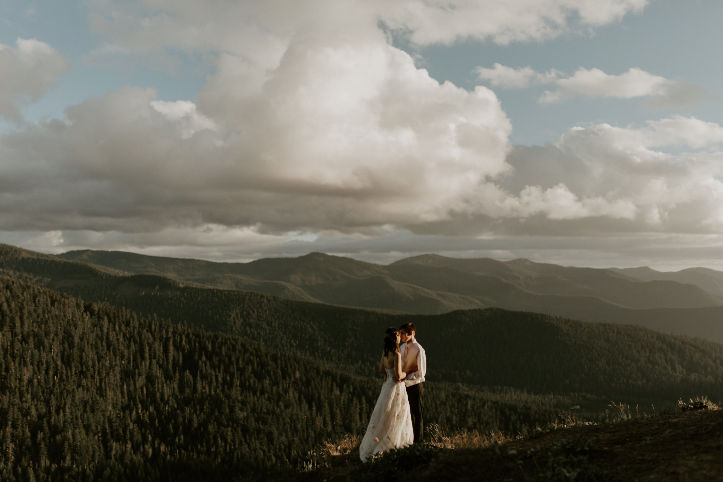Moira and Ryan move in for a kiss at Mount Hood. Adventure elopement wedding shoot by Sienna Plus Josh.