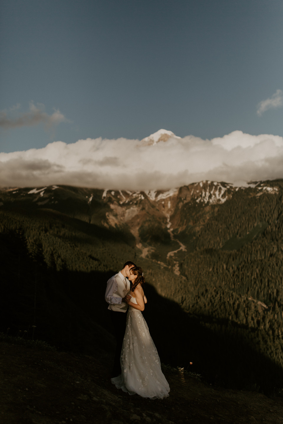 Ryan and Moira move in for a kiss in front of Mount Hood. Adventure elopement wedding shoot by Sienna Plus Josh.