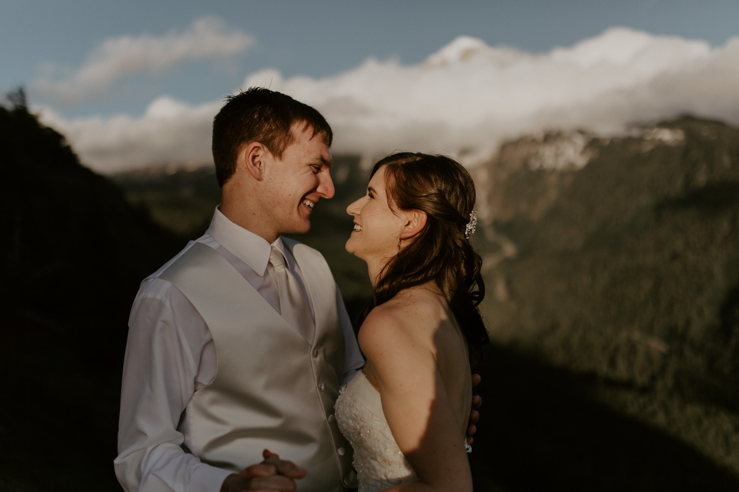 Moira and Ryans smile at each other near at Mount Hood. Adventure elopement wedding shoot by Sienna Plus Josh.