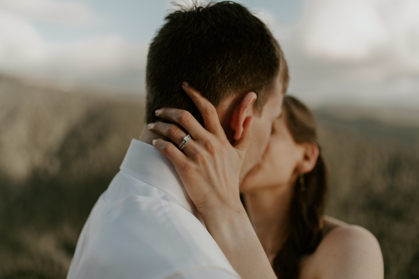 Moira and Ryan kiss in front of Mount Hood. Adventure elopement wedding shoot by Sienna Plus Josh.