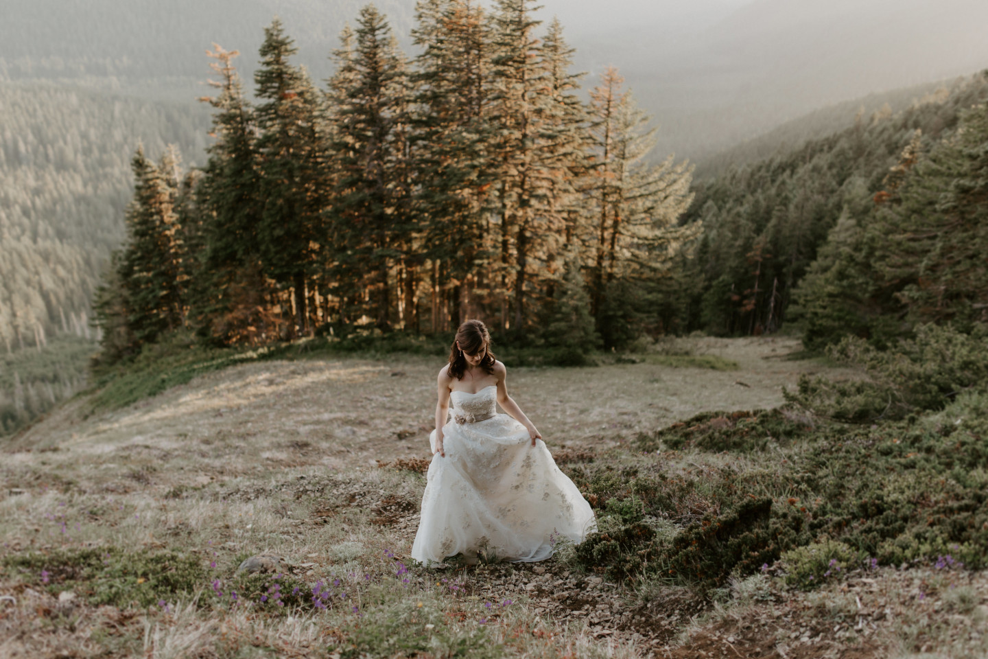 Moira walks up a slope on the trail near Mount Hood. Adventure elopement wedding shoot by Sienna Plus Josh.