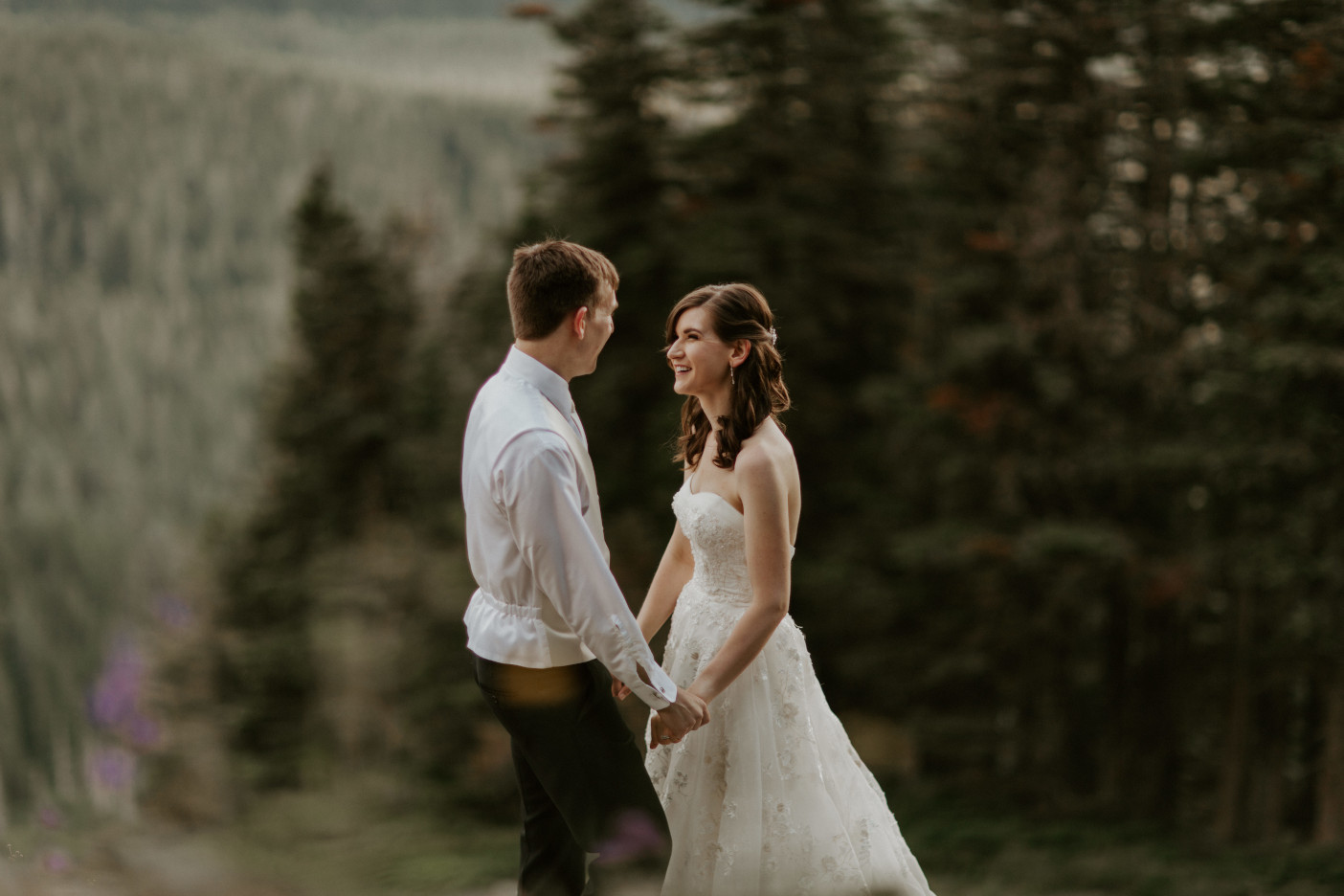 Moira and Ryan smile at eachother near the view at Mount Hood. Adventure elopement wedding shoot by Sienna Plus Josh.