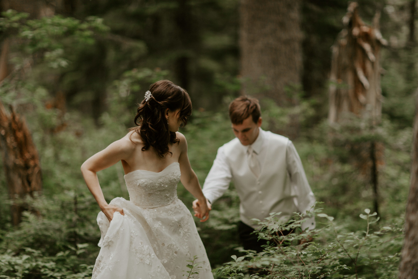 Moira guides Ryan along the trail to Mount Hood. Adventure elopement wedding shoot by Sienna Plus Josh.