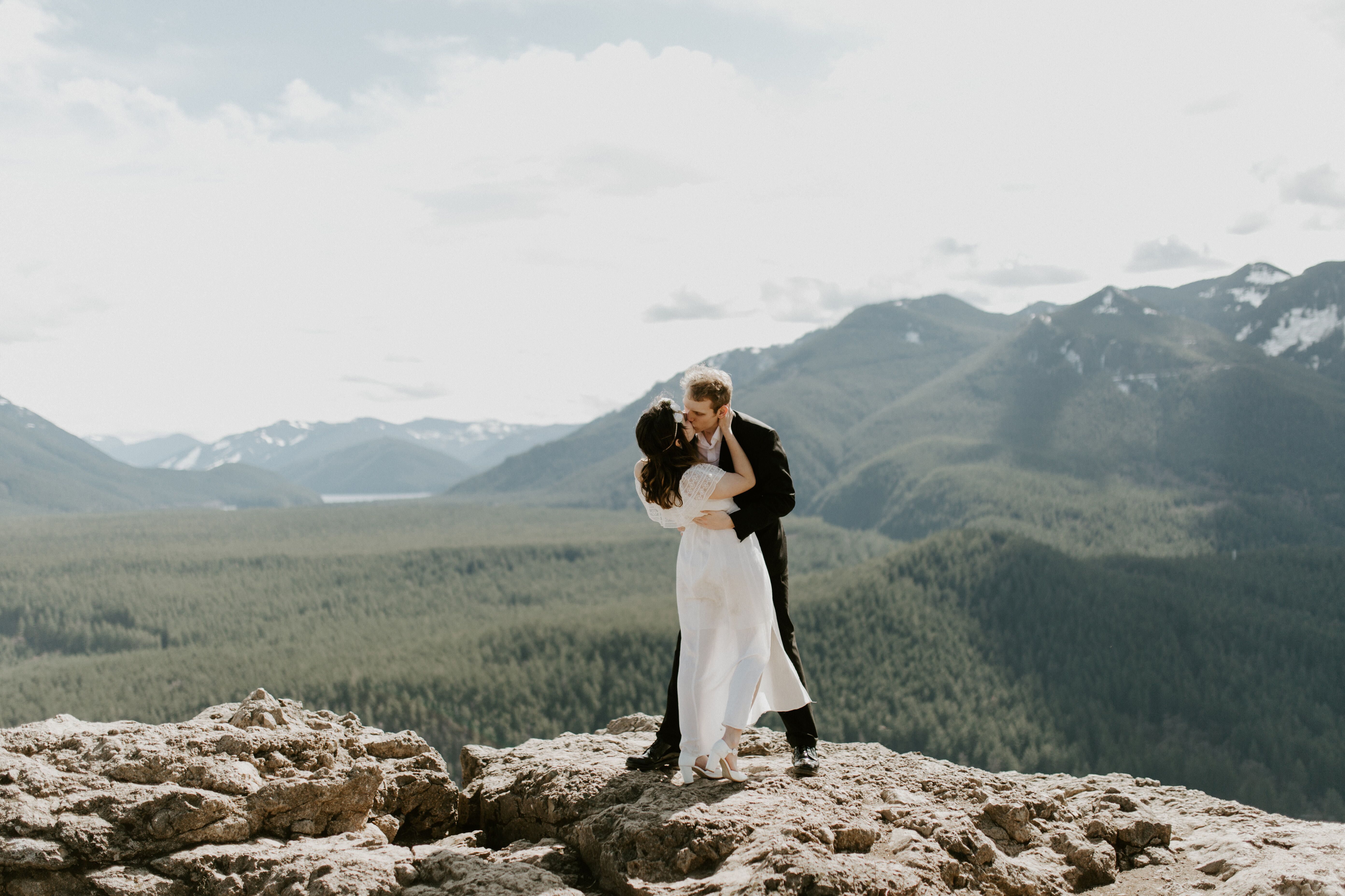 Michael and Winnifred kissing while standing near Rattlesnake Ledge, overlooking Washington.