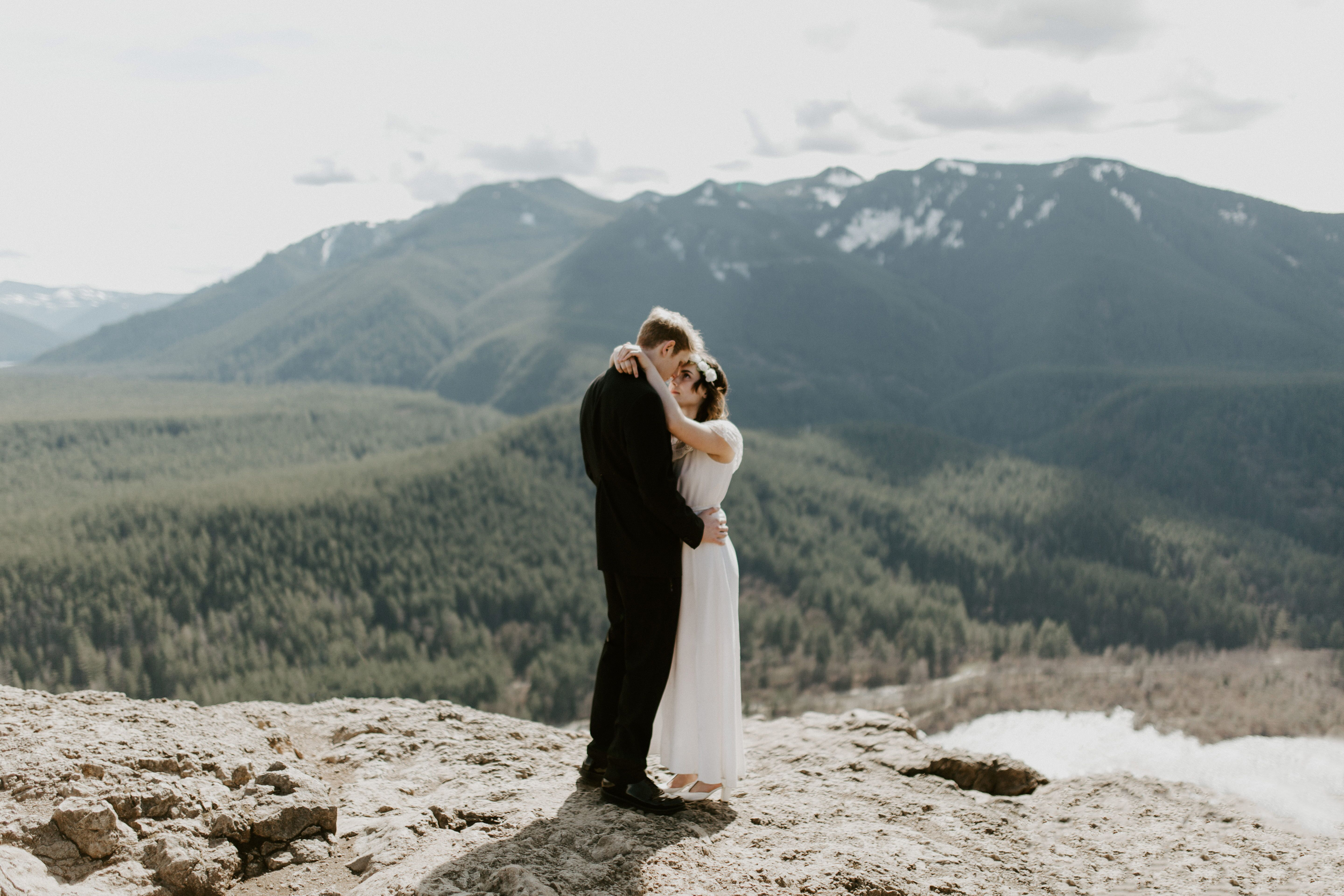 Michael and Winnifred hold eachother while standing on Rattlesnake Ledge. Elopement adventure shoot at Rattlesnake Ledge, Washington.