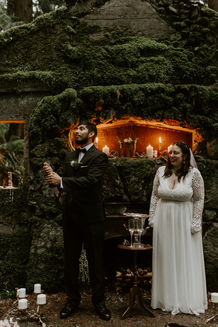 Sam pops open a bottle of Champagne at Skamania House, Washington. Elopement photography in Portland Oregon by Sienna Plus Josh.