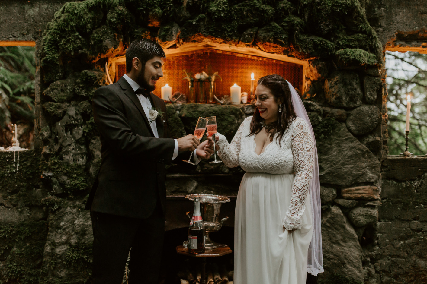 Sarah and Sam cheering with glasses of champagne at Skamania House, Washington. Elopement photography in Portland Oregon by Sienna Plus Josh.