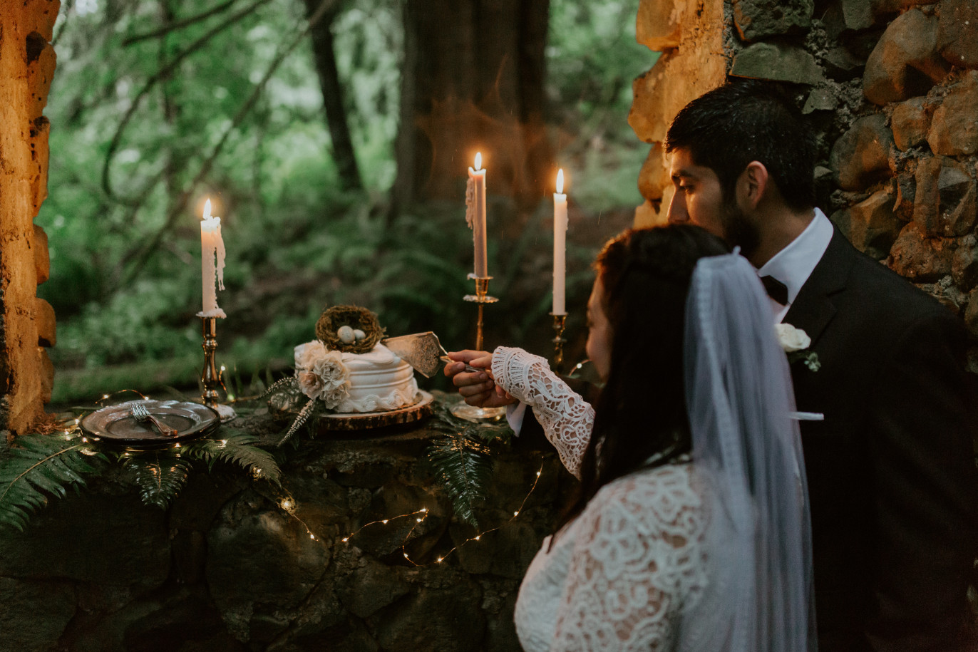 Sarah and Sam cut the wedding cake at Skamania House, Washington. Elopement photography in Portland Oregon by Sienna Plus Josh.
