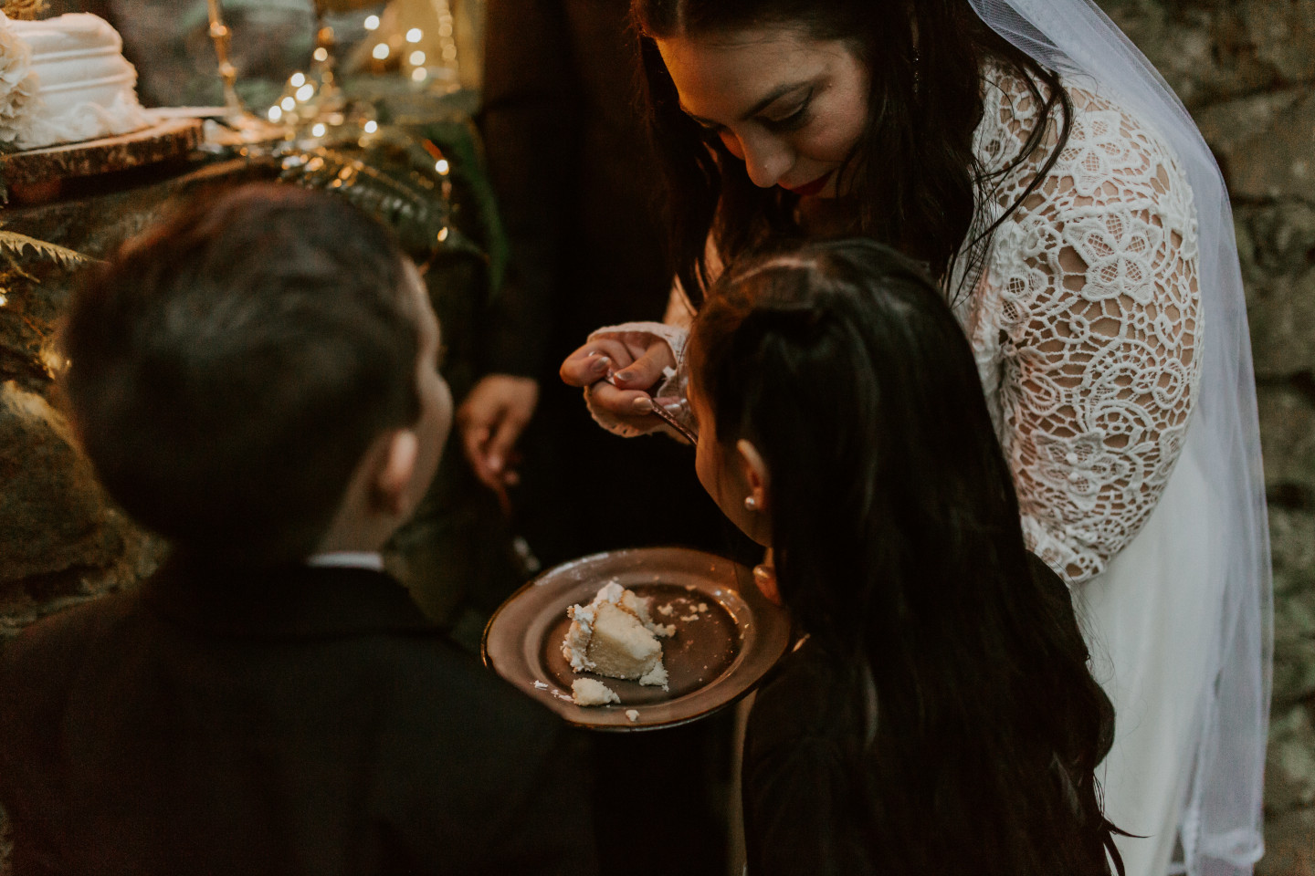 Sarah feeds her children cake at Skamania House, Washington. Elopement photography in Portland Oregon by Sienna Plus Josh.