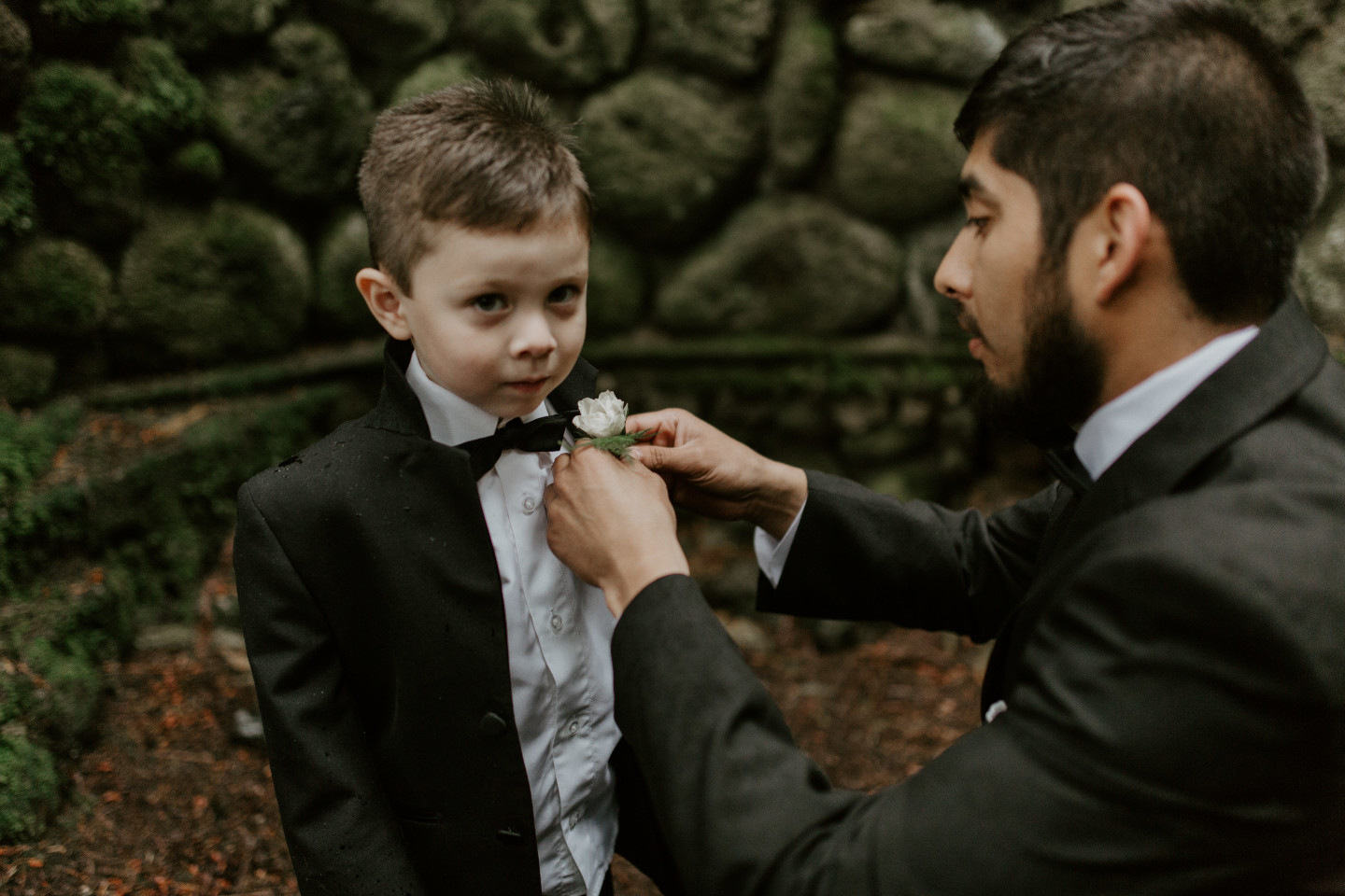 Sam gets his son ready for the ceremony in Skamania, Washington. Elopement photography in Portland Oregon by Sienna Plus Josh.