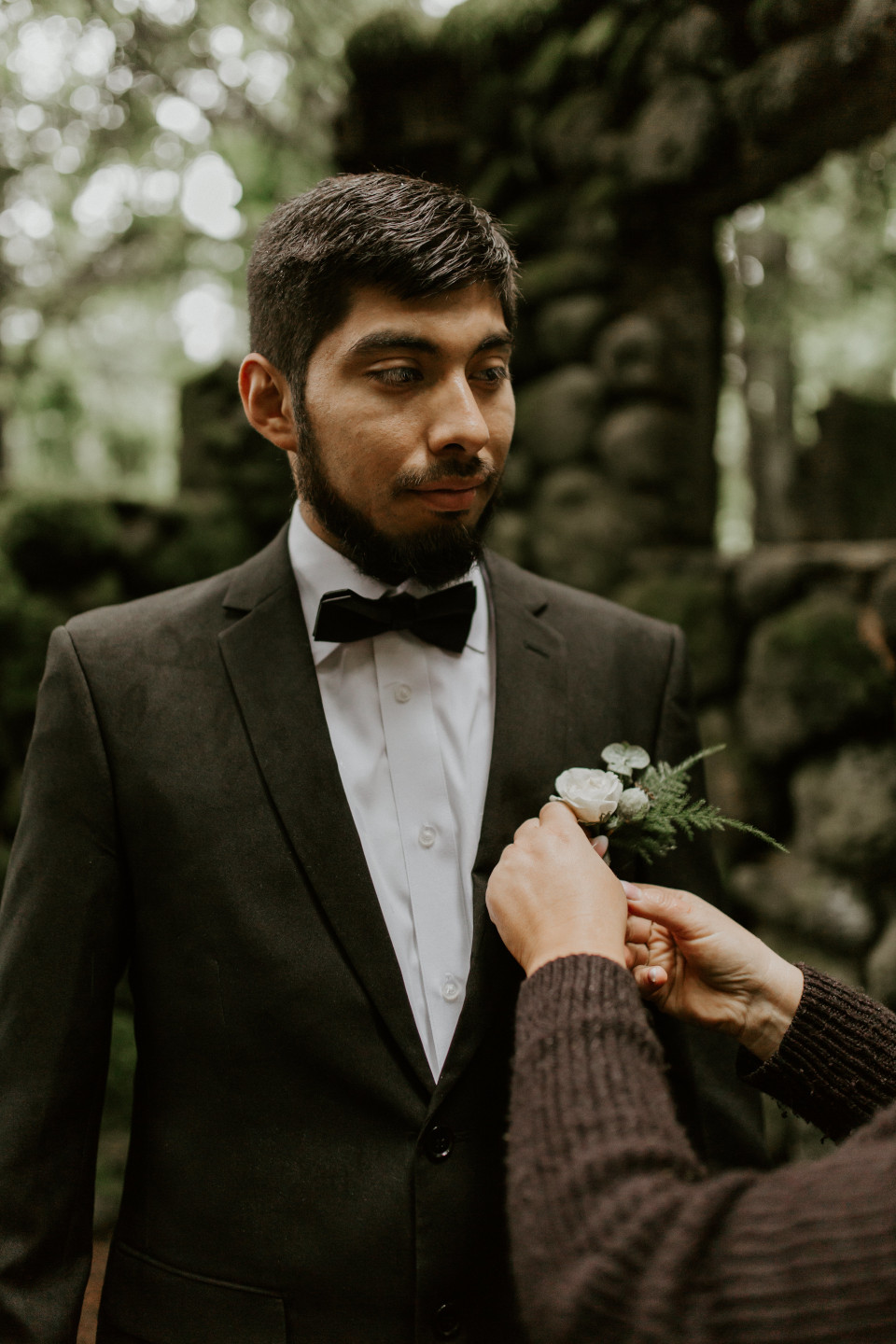 Sam gets ready at Skamania House, Washington during their Oregon Adventure. Elopement photography in Portland Oregon by Sienna Plus Josh.