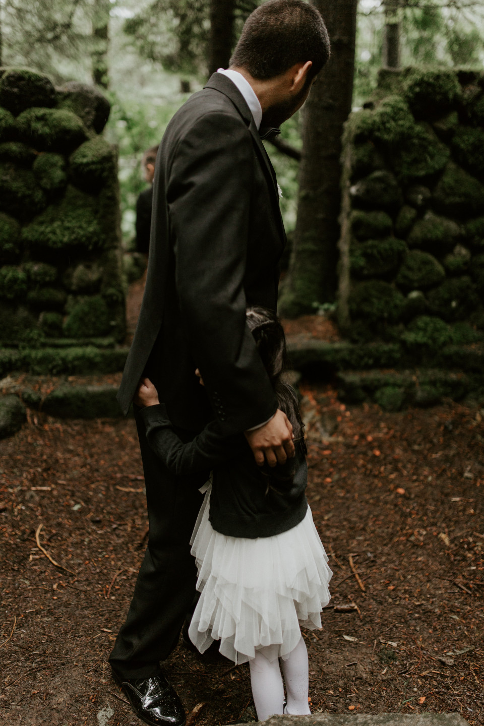 Sam hugs his daugther while they wait at Skamania House, Washington. Elopement photography in Portland Oregon by Sienna Plus Josh.