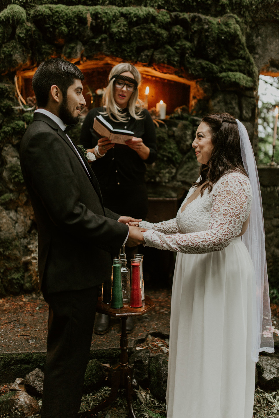 Sarah and Sam stand together at the altar at Skamania House, Washington. Elopement photography in Portland Oregon by Sienna Plus Josh.