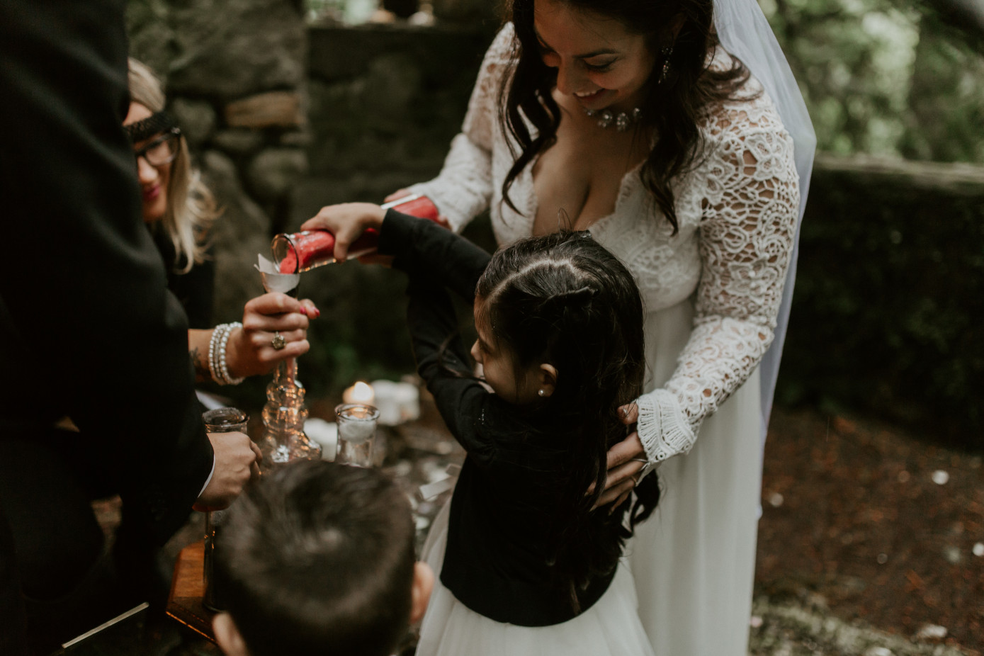 Sarah helps her daughter pour sand at Skamania House, Washington. Elopement photography in Portland Oregon by Sienna Plus Josh.