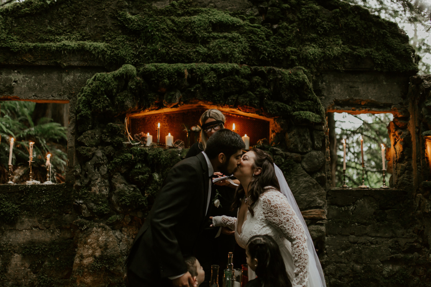 Sarah and Sam go in for a kiss at Skamania House in Oregon. Elopement photography in Portland Oregon by Sienna Plus Josh.