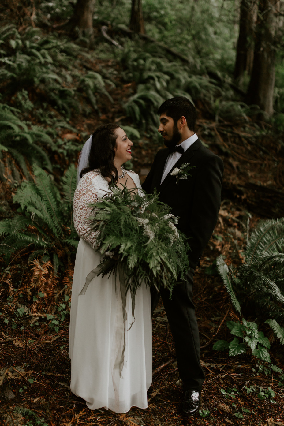 Sarah stands holding her boquet with Sam at the Skamania House in Washington. Elopement photography in Portland Oregon by Sienna Plus Josh.