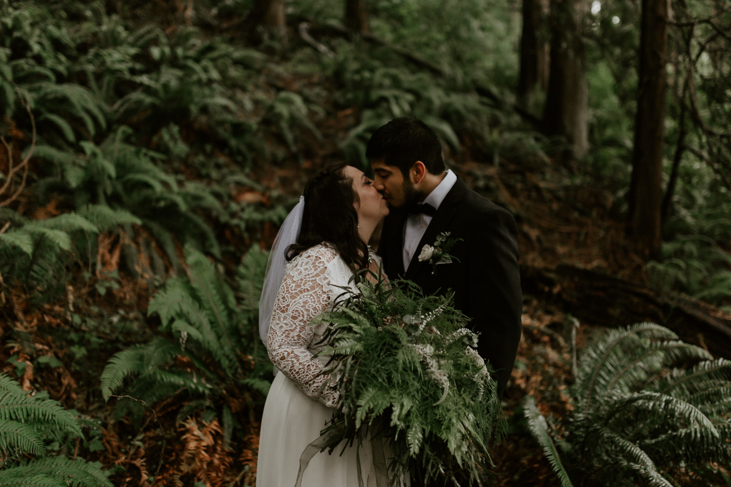 Sam and Sarah kiss at Skamania House in Oregon during their Adventure. Elopement photography in Portland Oregon by Sienna Plus Josh.