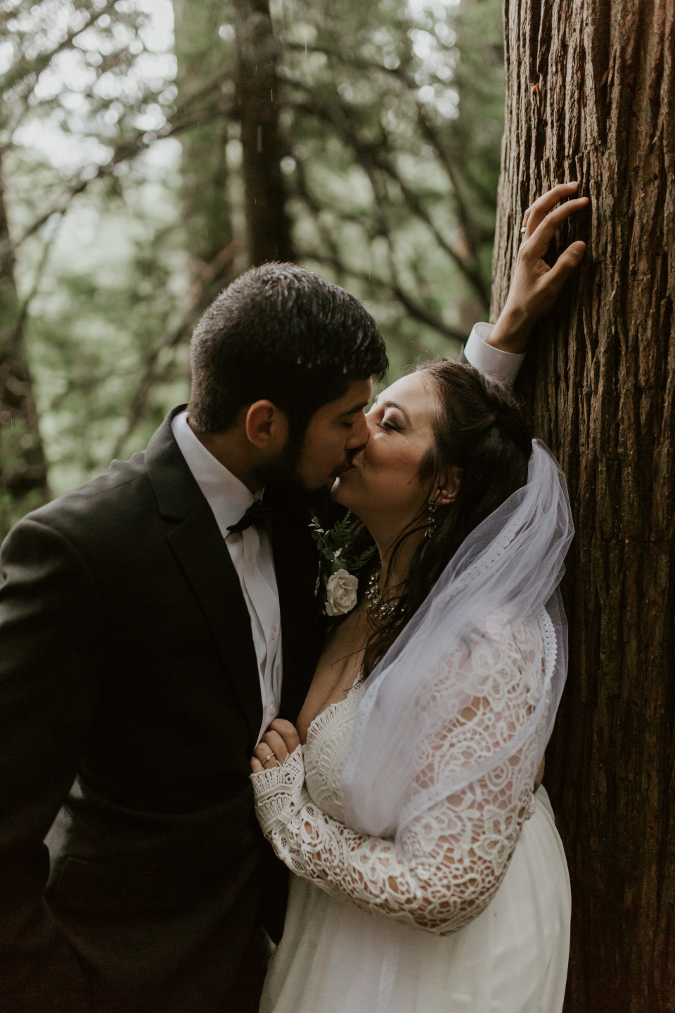 Sarah and Sam kiss under a tree at Skamania House, Washington. Elopement photography in Portland Oregon by Sienna Plus Josh.
