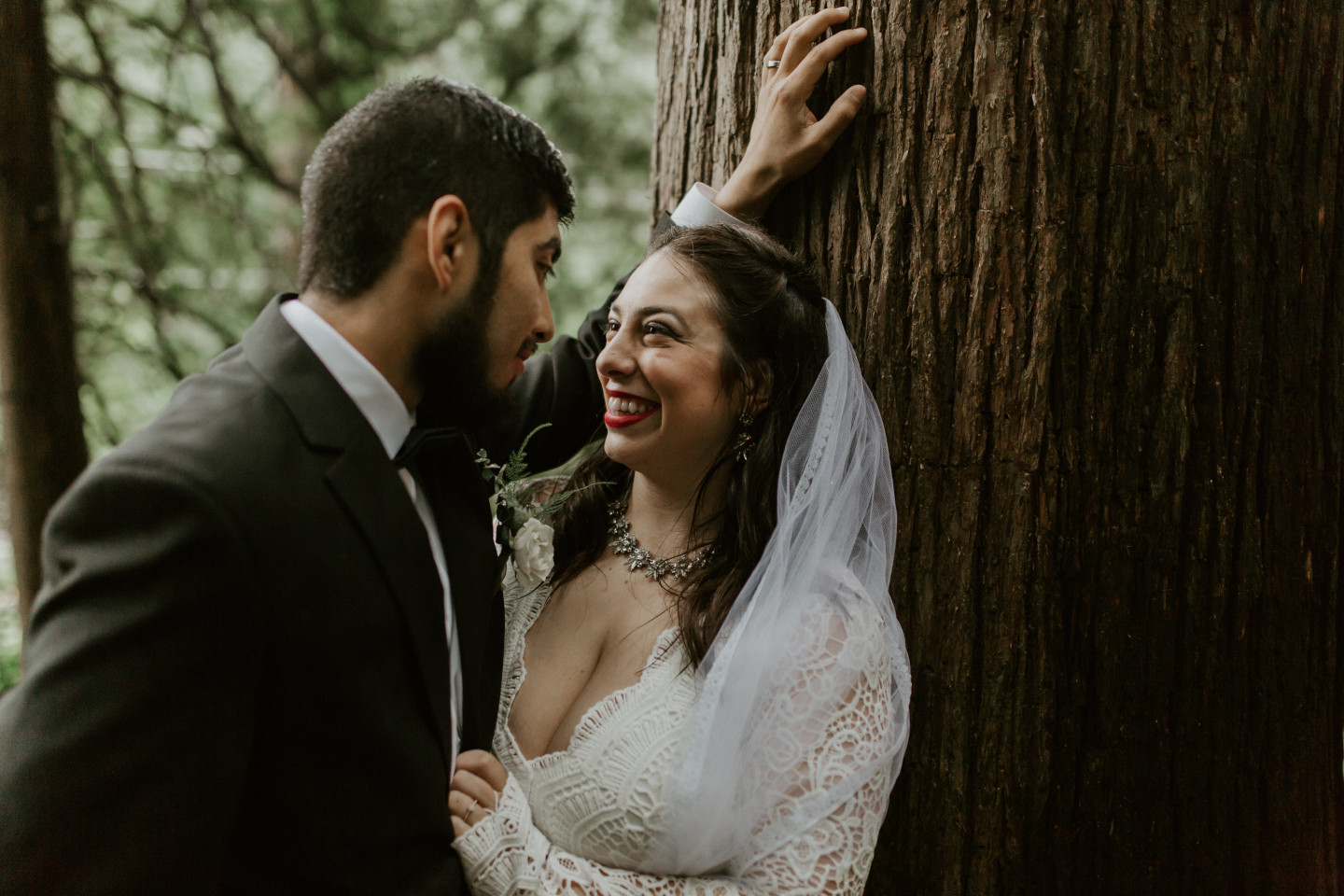 Sarah and Sam share a moment under a tree at Skamania House, Washington. Elopement photography in Portland Oregon by Sienna Plus Josh.