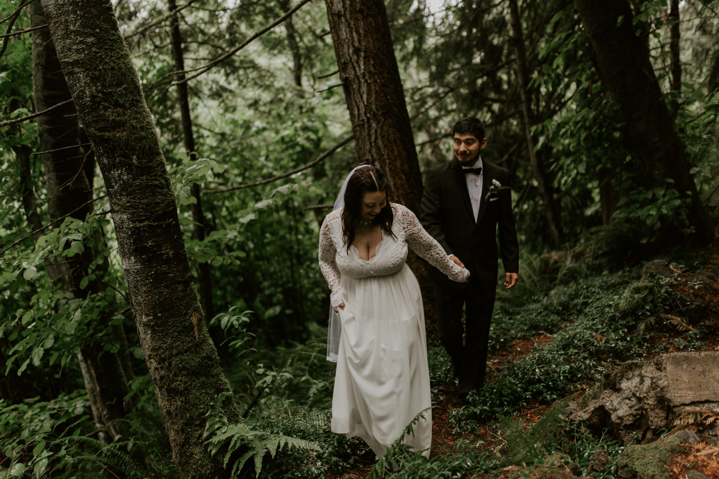 Sarah leads Sam through the forest at Skamania House, Washington. Elopement photography in Portland Oregon by Sienna Plus Josh.