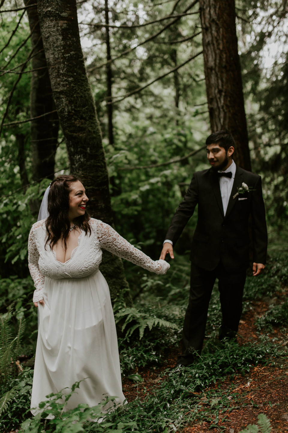 Sarah and Sam hold hands at Skamania House, Washington. Elopement photography in Portland Oregon by Sienna Plus Josh.
