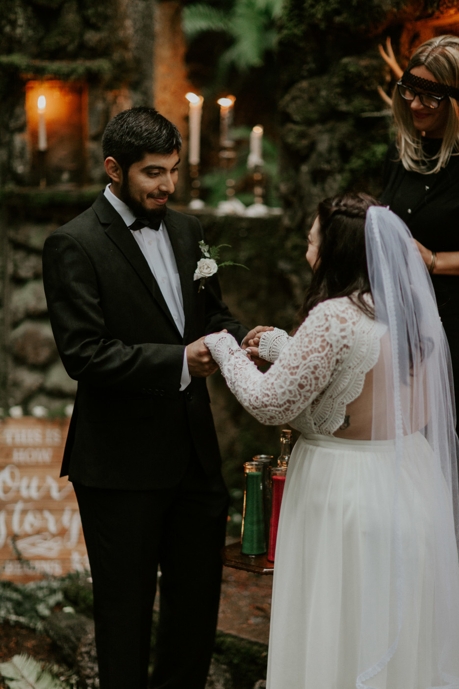Sarah and Sam hold each others hands at Skamania House, Washington. Elopement photography in Portland Oregon by Sienna Plus Josh.